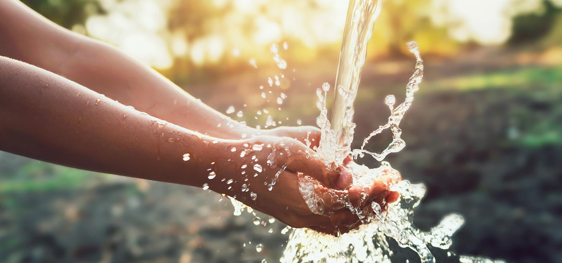Hands under clean water