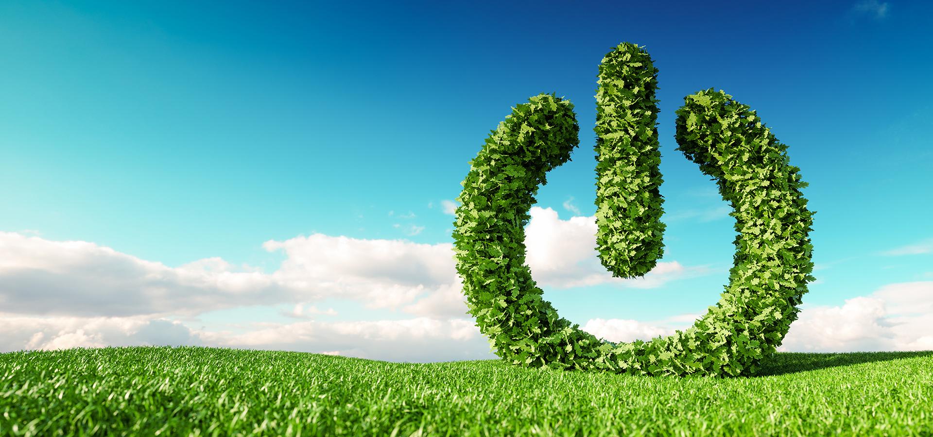 Green power symbol in a green field